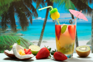 fruit cocktails in glass on the beach